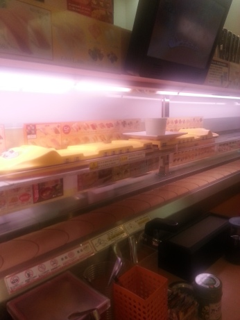 the yellow train brought your plates out to your table on conveyor belt