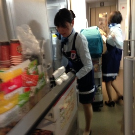 shinkansen attendants in their galley; reloading their carts